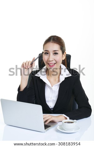 Business woman sitting in the office. Working using a laptop