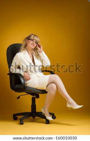 business woman sitting on a chair - stock photo