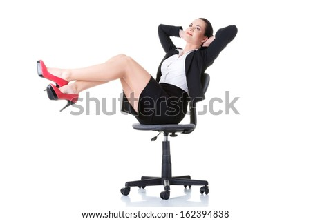 Business woman sitting on a chair with legs up. Isolated on white.  - stock photo