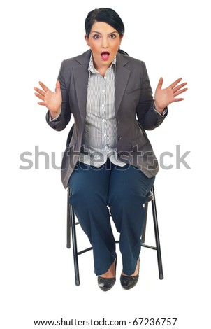 Business woman sitting on chair and being shocked by what seeing isolated on white background - stock photo