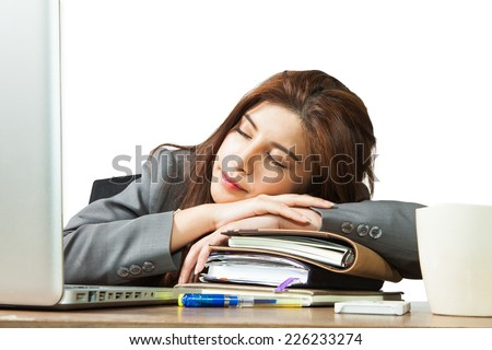 Business woman sleeping on laptop taking a power nap during work Isolated - stock photo