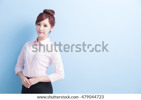 business woman smiles to you isolated on blue background, asian