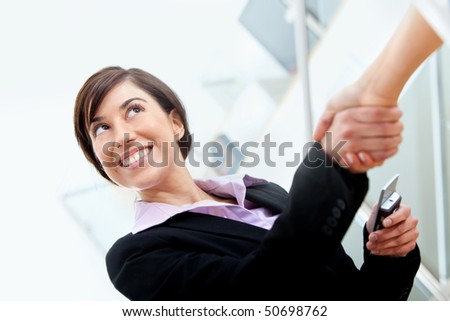 Business woman smiling and making a deal in her office - stock photo