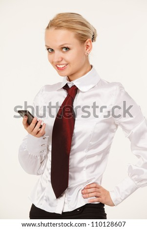 Business woman smiling with a phone in your hand