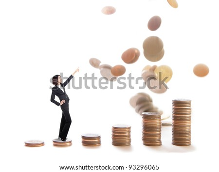 Business woman stand on money stairs and point up forward by finger, model is a asian beauty - stock photo