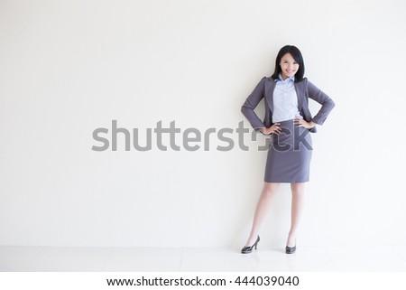 business woman stand with white wall background, great for your design or text, asian - stock photo