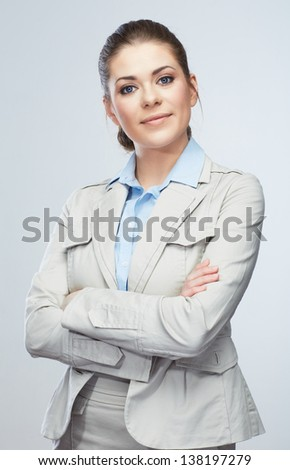 Business woman standing against isolated gray background. Female model.