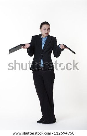 business woman standing holding two halves of a broken keyboard in her hand