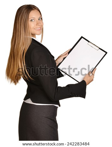 Business woman standing sideways and holding in hands clipboard - stock photo