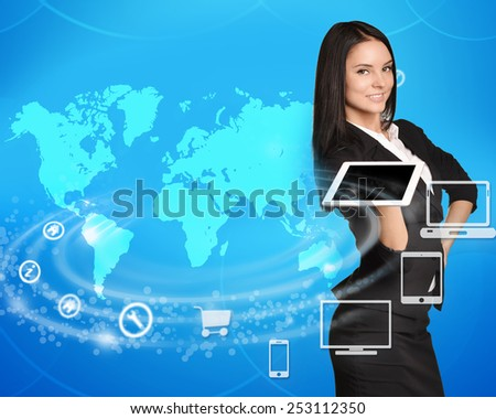 Business woman standing with tablet in hand on world map background. - stock photo