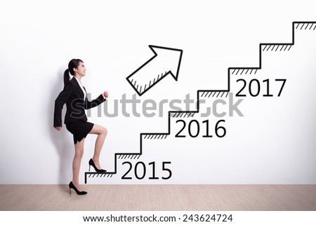 Business woman stepping up on stairs to gain her success in 2015 new year - stock photo