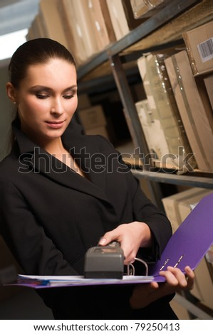 Business woman stock counting in warehouse - stock photo