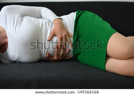 Business woman suffering from abdominal pain
