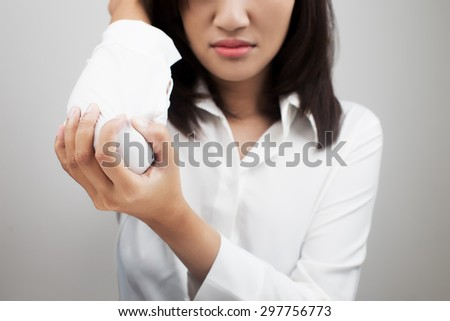 Business woman suffering from elbow pain