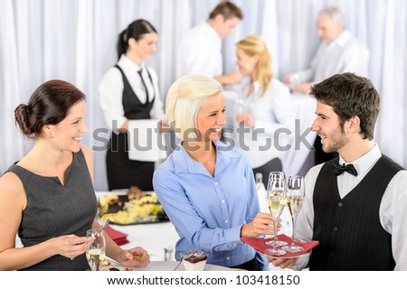 Business woman take aperitif from waiter during company seminar meeting - stock photo