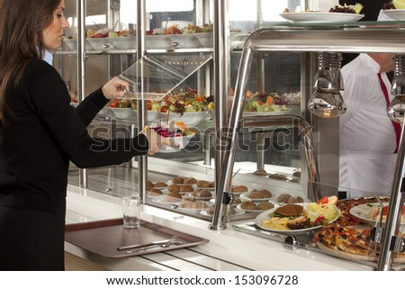 Business woman take cafeteria lunch - stock photo