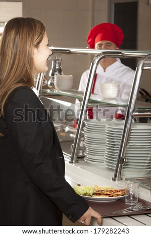 Business woman take cafeteria lunch