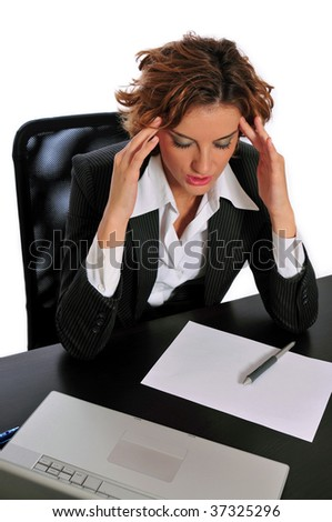 Business woman taking a break to de-stress by massaging the temples of her forehead at her desk. - stock photo