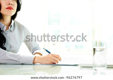 Business woman taking notes at seminar