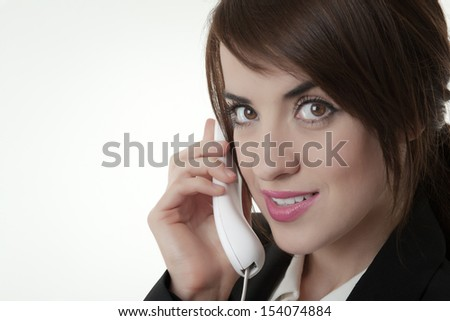 business woman taking on the phone looking happy - stock photo
