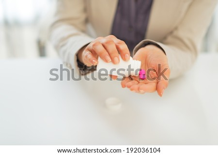 Business woman taking pills
