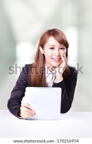 business woman talking and using tablet computer pc in office, model is a asian woman - stock photo