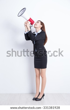 business woman talking in megaphone with white wall background, great for your design or text, asian