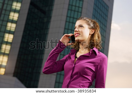 business woman talking on mobile phone outdoors