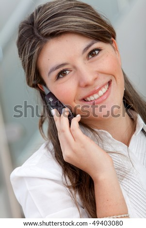 Business woman talking on the phone at the office