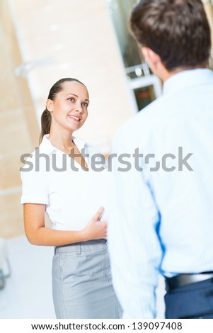 Business woman talking with a colleague in the office - stock photo