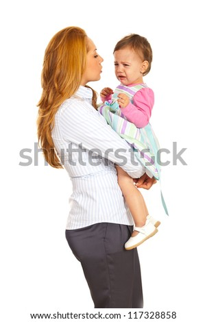 Business woman talking with her crying toddler girl isolated on white background - stock photo
