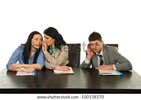 Business woman telling secret to her colleague and other colleague man trying to hear them  in office - stock photo