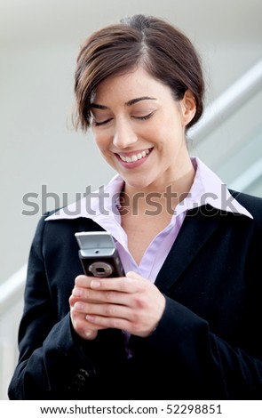 Business woman texting from her cell at the office - stock photo