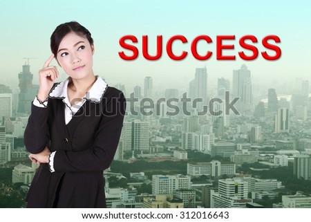 "business woman thinking about ""success"" with city background"