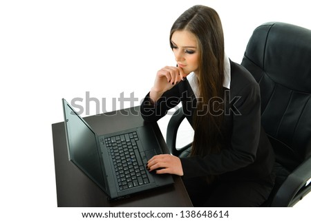 Business Woman Thinking at Her Desk - stock photo