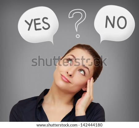 Business woman thinking yes or on in speech bubble on grey background - stock photo
