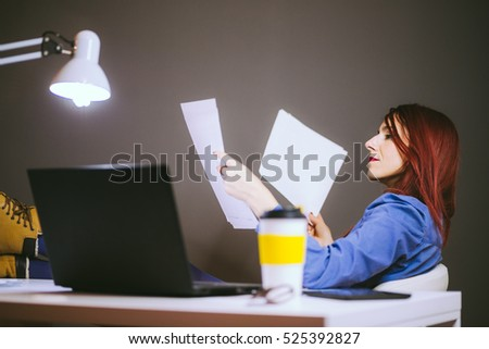 Business Woman Thoroughly Reading Paperworks