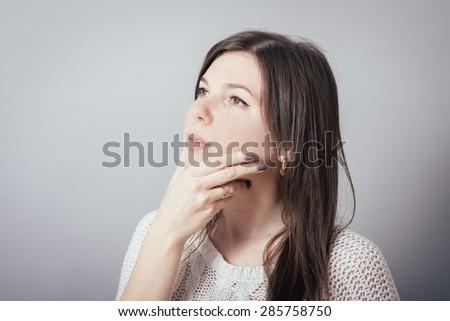 Business woman thoughtful - stock photo