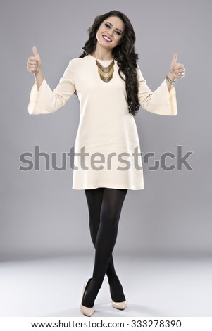 Business woman thumb up gesture, smile business woman, isolated on gray background - stock photo