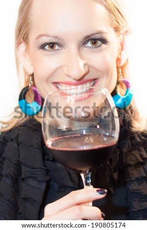 Business woman toasting with a glass of red wine. - stock photo