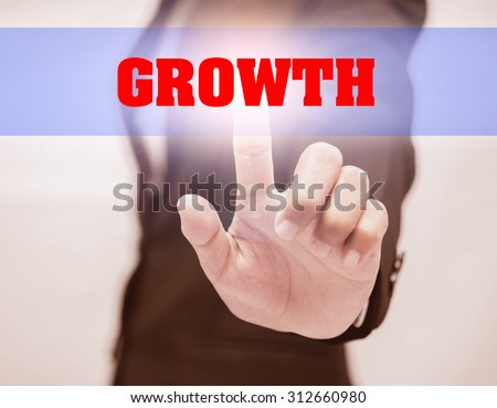 business woman touch GROWTH Text - stock photo
