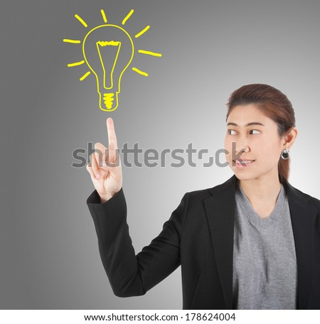 Business woman touch screen with lamp symbol. For business concept.