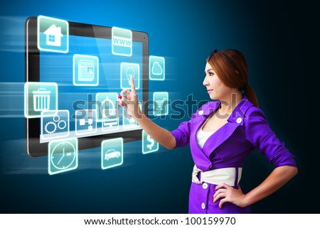 Business woman touch the many icons on tablet pc - stock photo