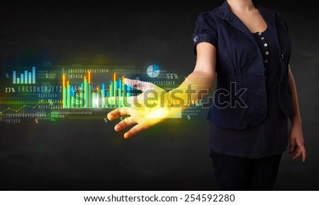 Business woman touching colorful charts and diagrams - stock photo