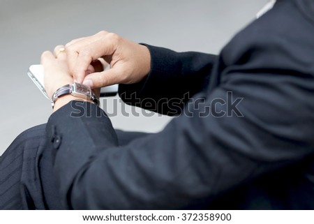Business woman touching her smartwatch.