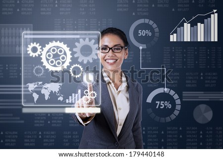 Business woman touching virtual screen of controlling system - stock photo
