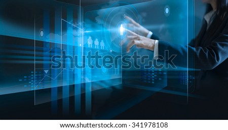business woman touching virtual screen, pushing icon on media at dark background  - stock photo