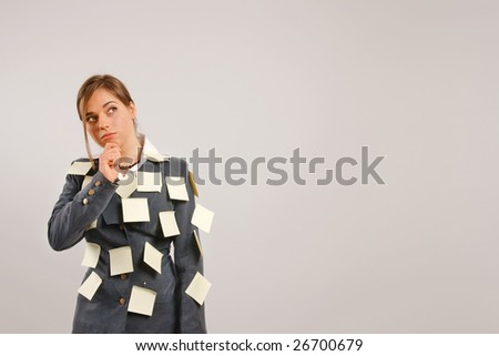 Business woman trying to remember with her suit is full of stickers