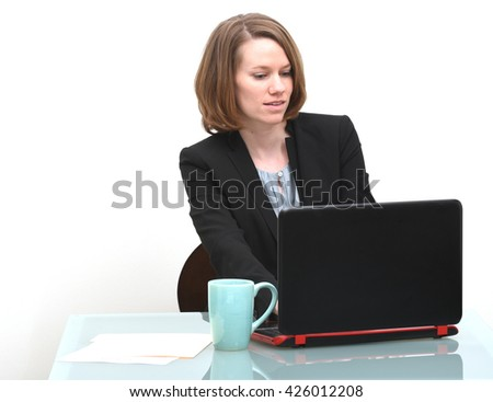 Business woman typing on keyboard of computer