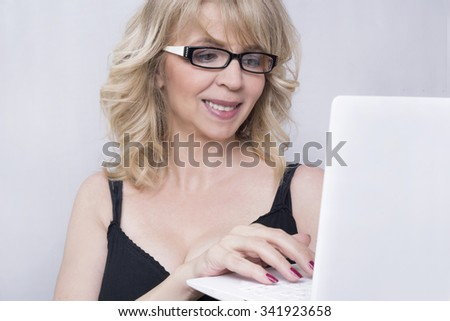 Business woman typing on lap top  - stock photo